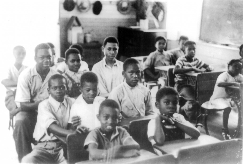 A photo of children attending a similar one-room school house which was located on Orange Picker Road.